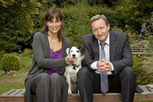 A Bentley Production for ITV1 MIDSOMER MURDERS coming soon to ITV1 Picture Shows: FIONA DOLMAN as Sarah Barnaby, Sykes and NEIL DUDGEON as DCI John Barnaby Picture Caption: New DCI John Barnaby arrives in Midsomer and is bemused by the quaint villages and their quirky residents. But when a local DJ is crushed to death at a traditional girls' boarding school, he soon discovers that murder and deception are never far away. As the death toll rises, could Barnaby's first case also be his last? For more information, please contact Emily Page on 020 715 73034 / emily.page@itv.com Source: Digital COPYRIGHT: BENTLEY PRODUCTIONS